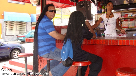 Beautifull people with very long hair in the streets of Willemstad